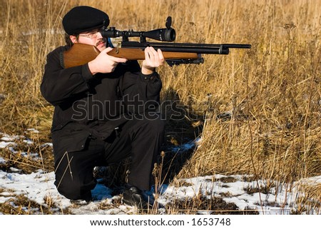 Hunter or sniper aiming to his victim - stock photo