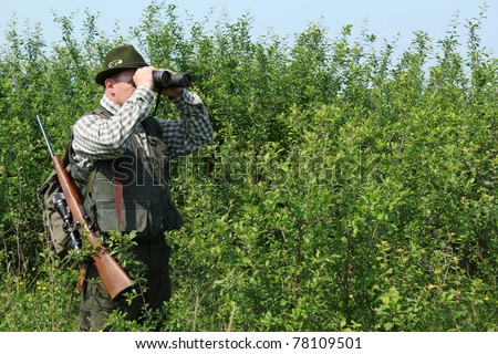 hunter with binoculars - stock photo