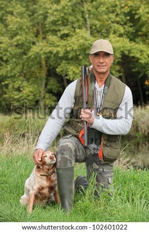 Hunter with dog - stock photo
