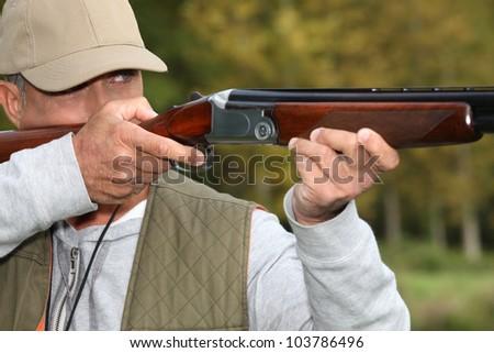 Hunter with rifle - stock photo