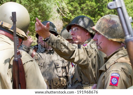 HUNTERSVILLE, NC - MAY 3, 2014:  Military reenactors in American uniforms recreate a World War II battle at Historic Latta Plantation in commemoration of the 70th anniversary of D-Day.