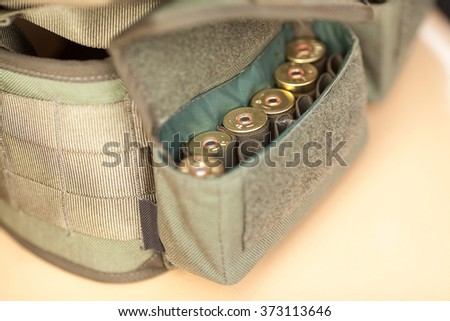 Hunting cartridges. Cartridges in the bandoleer. Cartridges close up. - stock photo