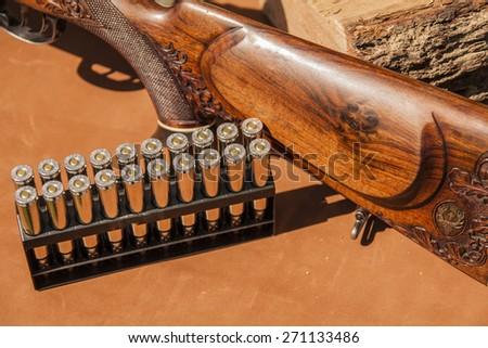 hunting rifle and ammunition - stock photo