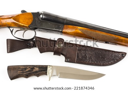 Hunting rifle, knife and leather case on white - stock photo