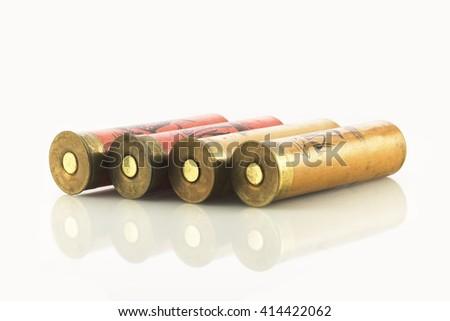 Hunting shotgun shells on white - stock photo
