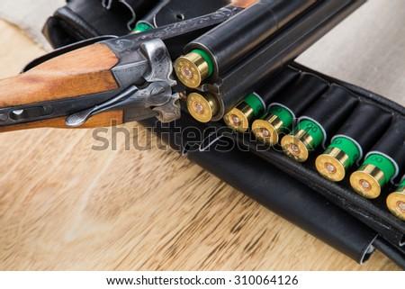 Hunting shotgun with bullets - stock photo