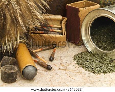 hunting theme with old matches, fox fur and gunpowder at beige - stock photo