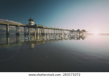 Huntington Beach Pier at low tide processed with a vintage retro filter - stock photo