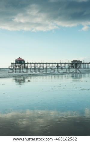 Huntington Beach Pier at Low Tide with Cloudy Blue Skies
