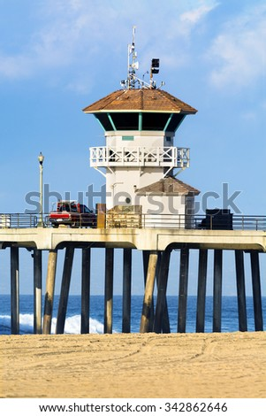 Huntington Beach watchtower on the historic pier during a bright, sunny day. - stock photo