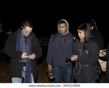 HUNTINGTON, NEW YORK, USA - NOVEMBER 14: Ron Yacovetti checks recording device during Brooklyn Paranormal Society's investigation of Mount Misery Road in Long Island.  Taken November 14, 2015 in NY.  - stock photo