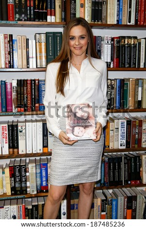 HUNTINGTON, NY-APR 15: Actress Alicia Silverstone signs copies of her book 'The Kind Mama' on April 15, 2014 at the Book Revue in Huntington, New York. - stock photo