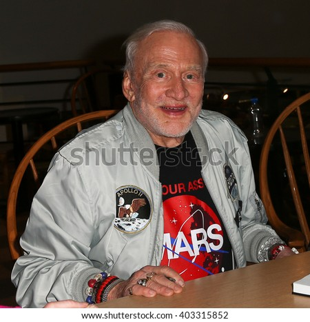 "HUNTINGTON, NY-APR 5: Former astronaut Buzz Aldrin signs his book ""No Dream Is Too High: Life Lessons From A Man Who Walked on the Moon"" at Book Revue on April 5, 2016 in Huntington, New York. - stock photo"