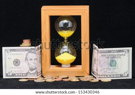 Huorglass and Money - Time is Money - stock photo