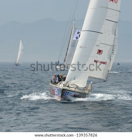 """HUPO, SOUTH KOREA - MAY19: Korea Cup International Yacht Race. Team """"Decision"""" ; struggling for first place, 19 May 2012. Hupo, South Korea - stock photo"""