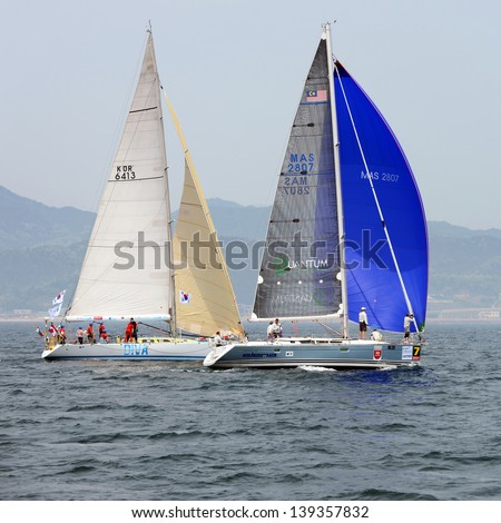 "HUPO, SOUTH KOREA - MAY 19: Korea Cup International Yacht Race. Team ""Diva"" and ""Elena"" struggling for first place, May 19, 2012. Hupo, South Korea"
