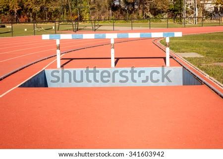 Hurdle. Moat. Running track. - stock photo