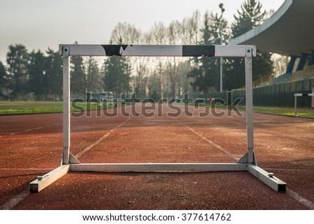 Hurdle on track - stock photo