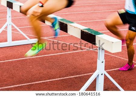 Hurdle Race (motion blur) - stock photo