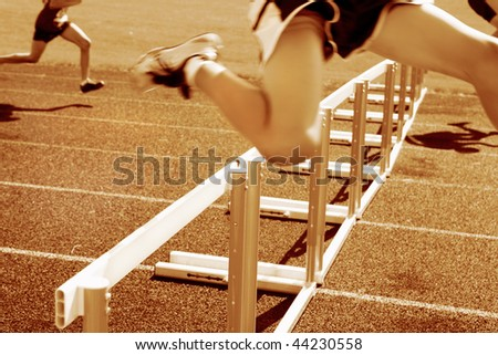 Hurdle race, motion blur on runners - stock photo