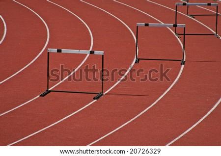 Hurdles in athletic field - stock photo