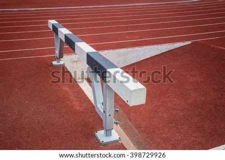 hurdles in running track for running sprint jump over race. - stock photo