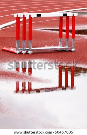 Hurdles near the runway on a wet, rainy day - stock photo