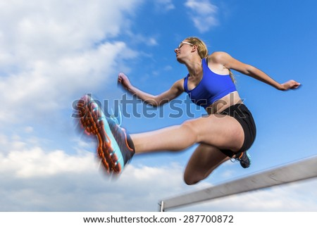 hurdling in track and field - stock photo
