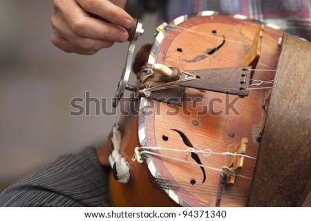 Hurdy-gurdy player in Brittany, France