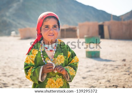 HURGHADA, EGYPT - APR 16, 2013: Unidentified bedouin people in the village on the desert near Hurghada, April 16, 2013. This Village is one of main tourist attractions on desert in Egypt. - stock photo