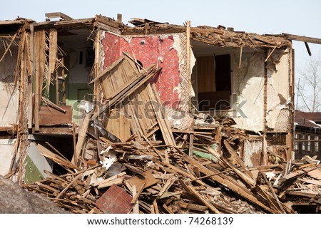 Hurricane earthquake disaster damage ruined house - stock photo