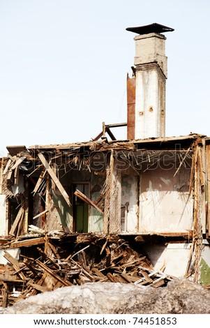 Hurricane earthquake disaster damage ruined house - stock photo