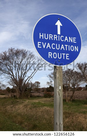 Hurricane Evacuation Route - blue round sign - stock photo