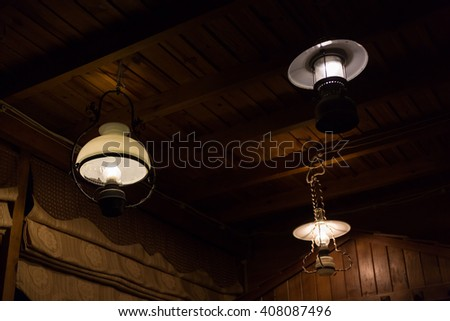 hurricane lamp design electricity lamplight hanging decorate home interior design on wooden ceiling wall
