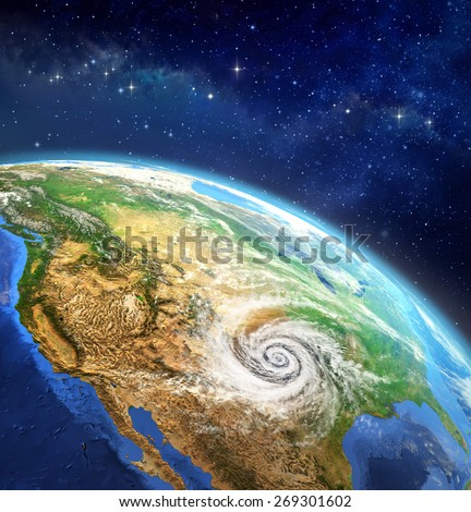 Hurricane over the Earth. Very high definition picture of planet earth in outer space with a cyclone on USA soil. Elements of this image furnished by NASA - stock photo