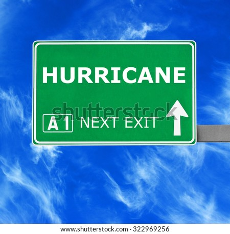 HURRICANE  road sign against clear blue sky - stock photo