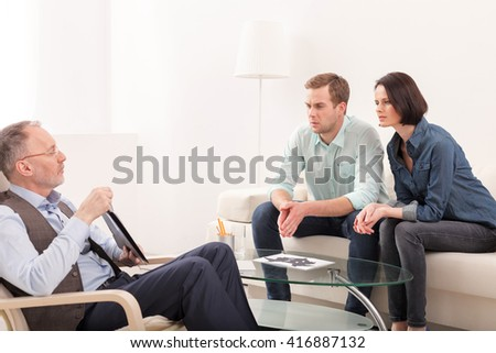 Husband and wife are consulting a psychologist - stock photo