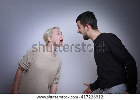 Husband and wife arguing, man and woman screaming. Family quarrel - stock photo