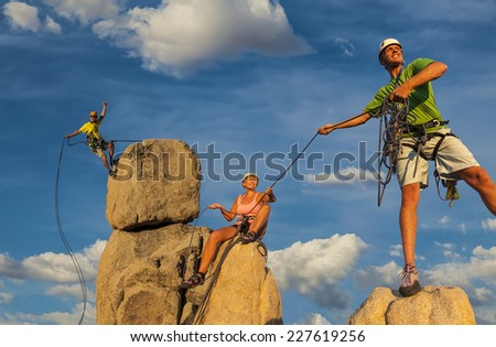 Husband and wife climbing team on the summit of a challenging ascent. - stock photo
