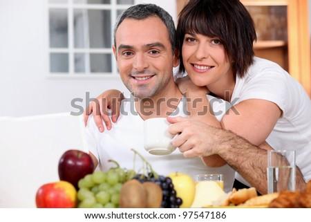 husband and wife having breakfast - stock photo