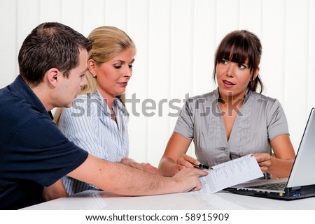 Husband and wife in a consultation - stock photo
