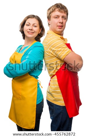 husband and wife in aprons posing on a white background - stock photo