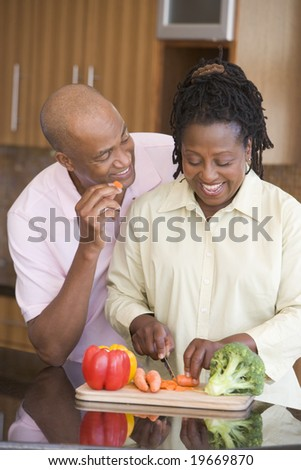 Husband And Wife Preparing A meal,mealtime Together