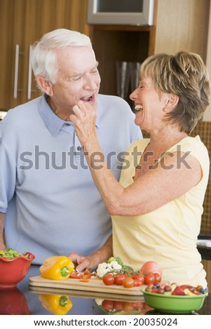 Husband And Wife Preparing Vegetables - stock photo