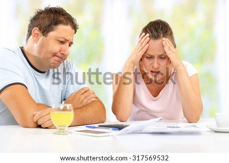 Husband and wife struggling to make ends meet - stock photo