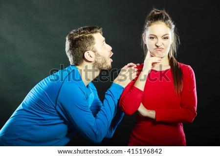 stock photo husband apologizing wife asking woman forgivness boyfriend trying convince girlfriend