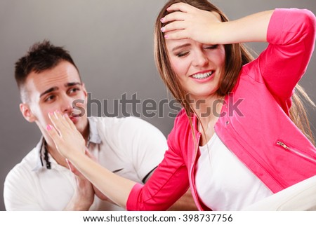 Husband apologizing wife. Upset, angry, mad woman refuses apology pushing him away. Boyfriend trying to convince girlfriend. Man asking for forgivness. Conflicted couple. Relationship problem. - stock photo