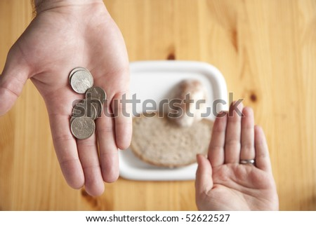 Husband giving money for shopping