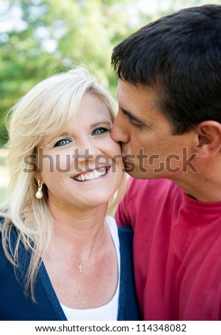 Husband giving wife a kiss on the cheek