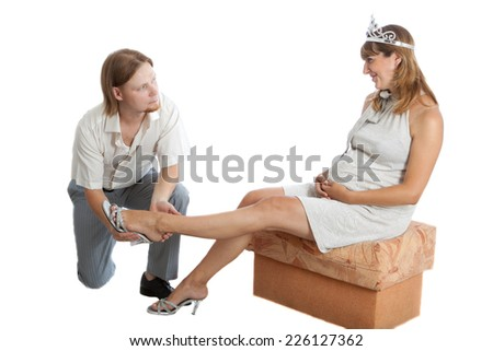 husband helps a happy young pregnant woman - stock photo
